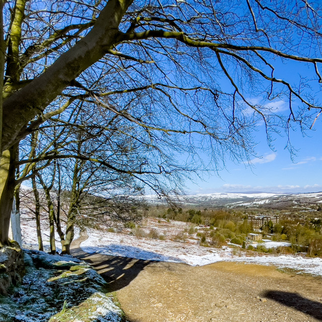 """View from White Wells, Rombalds Moor, Ilkley, Yorkshire, England, UK. Snow on the ground."" stock image"