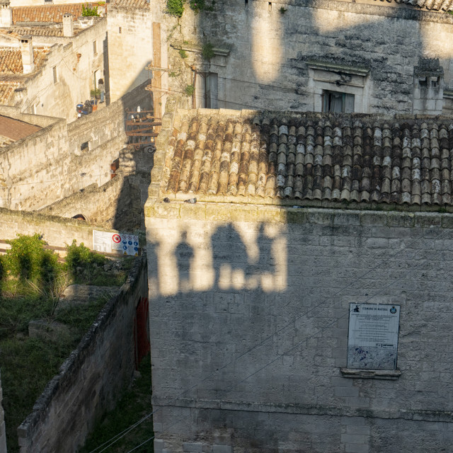 """""""Silhouettes of tourists in Matera ,Puglia, Italy"""" stock image"""