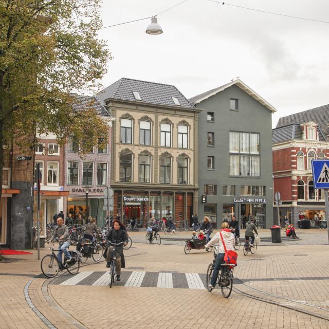 """People biking in the city of Groningen"" stock image"