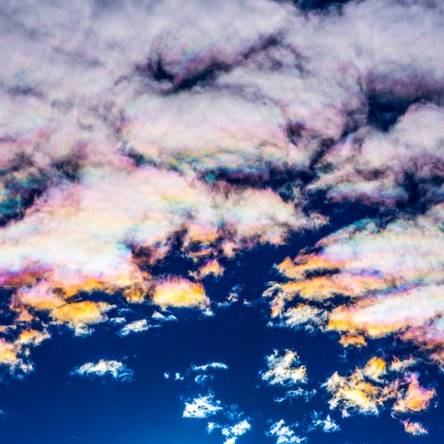 """""""Iridescent Cloud Rainbows in the sky over Reykjavik, Iceland"""" stock image"""