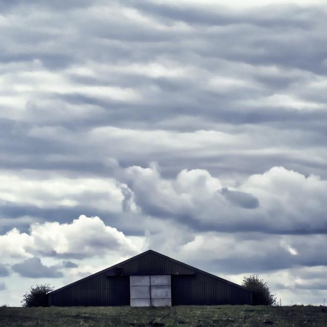 """Triangular Barn Cloudscape"" stock image"