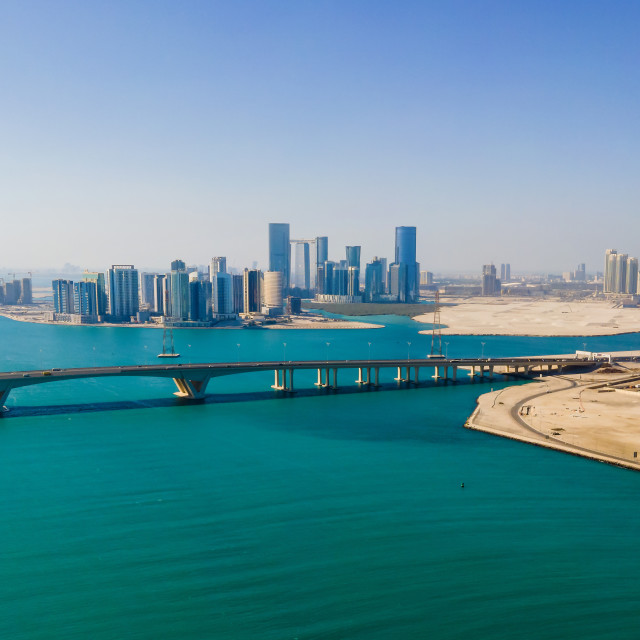 """""""Aerial view of Abu Dhabi skyline rising over the seaside forming"""" stock image"""