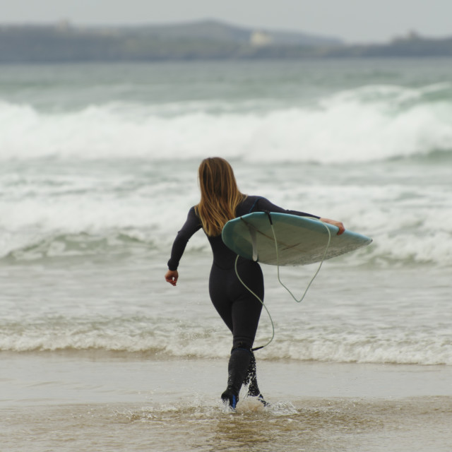 """Surfer at Watergate Bay, Cornwall"" stock image"