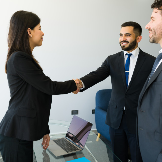 """""""Business executives shaking hands at the office"""" stock image"""