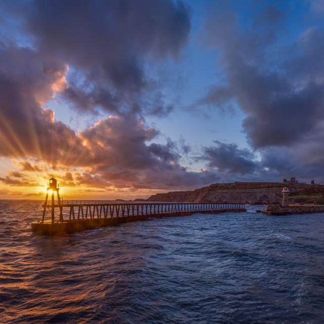 """""""Sunrise on Whitby Pier"""" stock image"""