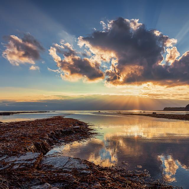 """Sunset Sunbeams at Kimmeridge Bay"" stock image"