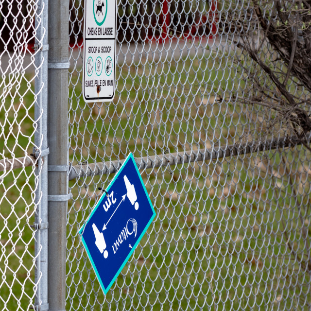 """""""City of Ottawa outdoor COVID-19 pandemic sign inverted and askew"""" stock image"""