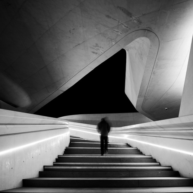 """""""Unrecognized person walking at the stairs leading to a bright open space. Eleftheria square Nicosia Cyprus"""" stock image"""
