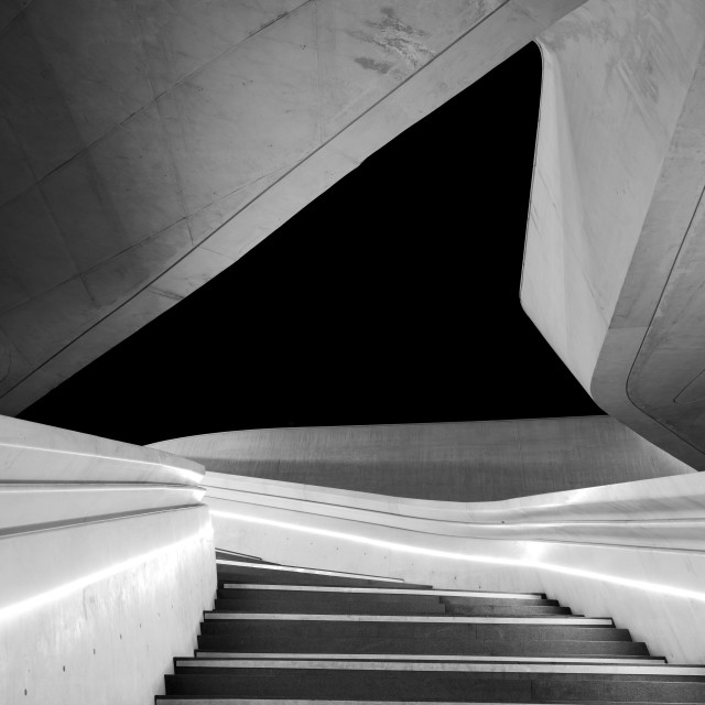 """""""Modern architecture and empty staircase leading to a bright open space."""" stock image"""