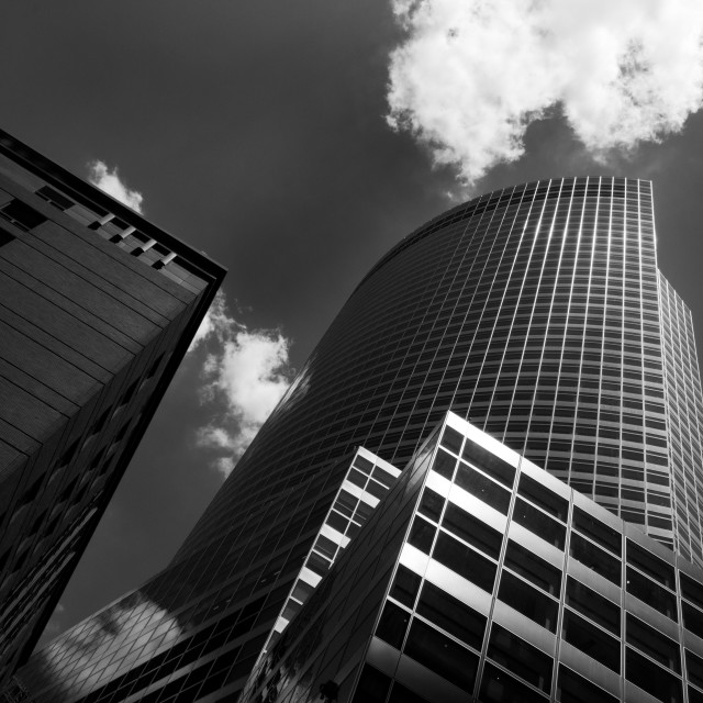 """""""Modern architecture design of a Skyscaper building. Black and white futuristic exterior against cloudy sky"""" stock image"""