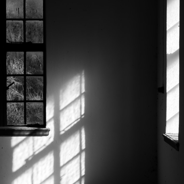 """""""Empty abandoned room and dramatic bright sunlight entering the window"""" stock image"""