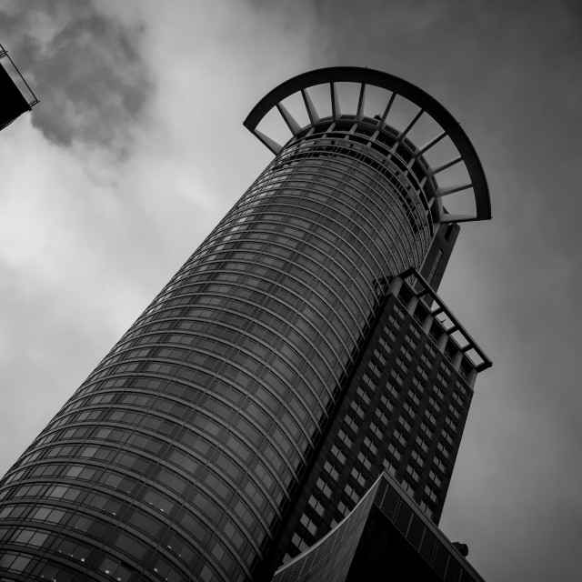 """""""Modern architecture design of a Skyscraper building. Black and white futuristic exterior against cloudy sky"""" stock image"""