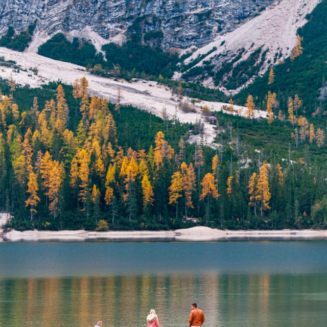 """""""People enjoying the Lago di Braise in the dolomite of the Italian alps in Autumn. Italy South Tyrol"""" stock image"""