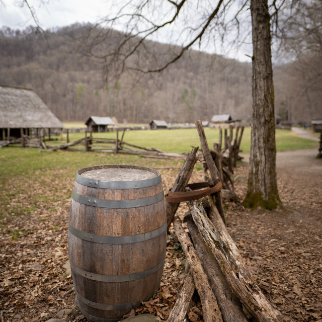 """""""barrel next to a rustic fence in a historic site"""" stock image"""