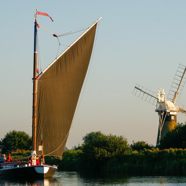 """Wherry passes St Benets Level Windmill"" stock image"