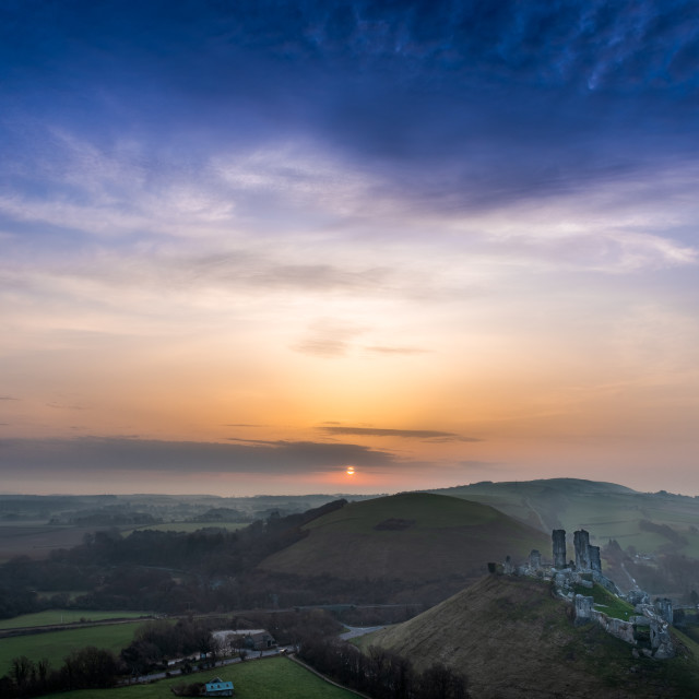"""Corfe Castle at sunrise"" stock image"