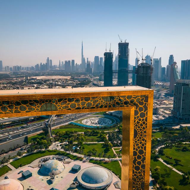 """Dubai skyline seen through Dubai Frame building with Zabeel park and Dubai skyline aerial cityscape view of the Emirate"" stock image"