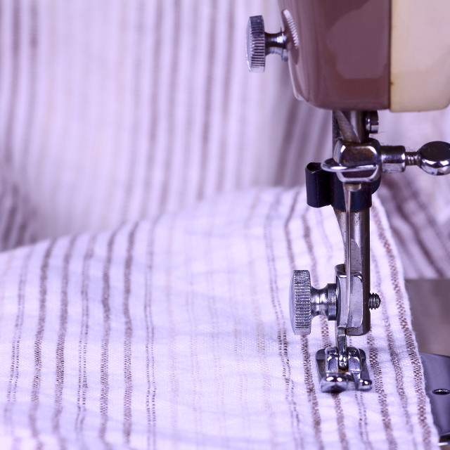 """""""Striped cotton material and a vintage sewing machine in close up"""" stock image"""