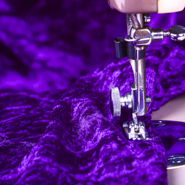 """""""Crushed velvet purple material with a close up of a vintage sewing machine"""" stock image"""