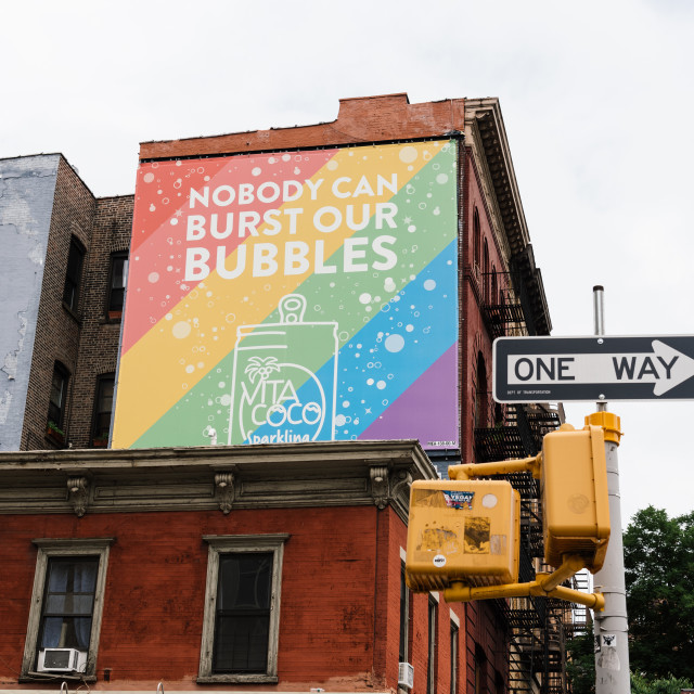 """""""Advertising billboard of Vita Coco on the facade of a traditional building in Greenwich Village in New York"""" stock image"""