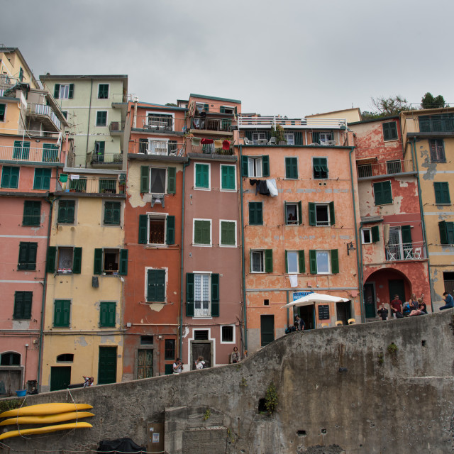 """""""Village of Manarola with colourful houses with tourists walking in the narrow streets. Cinque Terre, Liguria, Italy"""" stock image"""