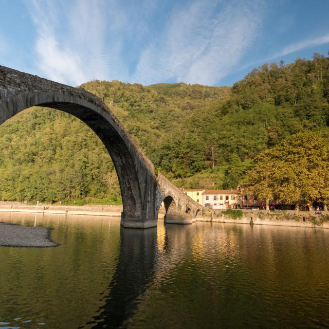 """""""The Devils bridge or Ponte della Maddalena above Serchio river. Bongo a Mozzani town in Tuscany, Italy"""" stock image"""