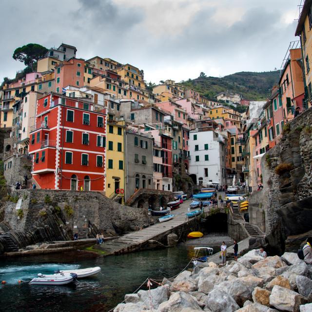 """Village of Manarola with colourful houses at the edge of the cliff Riomaggiore,Cinque Terre, Liguria, Italy"" stock image"