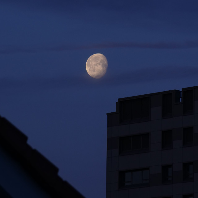 """""""Moon over the City"""" stock image"""