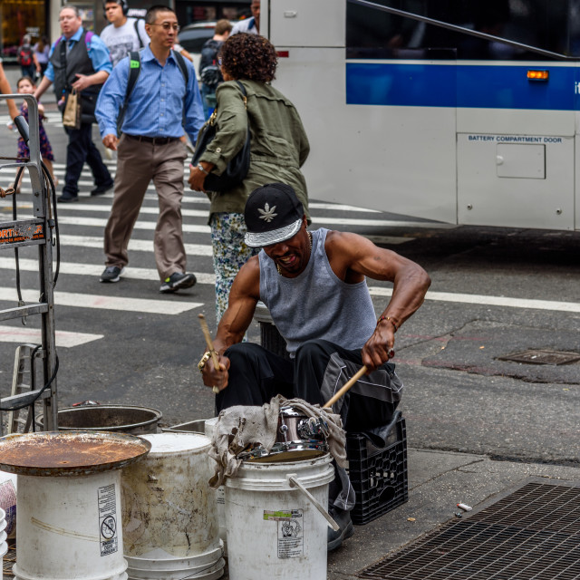 """""""Black man playing drums in New York"""" stock image"""