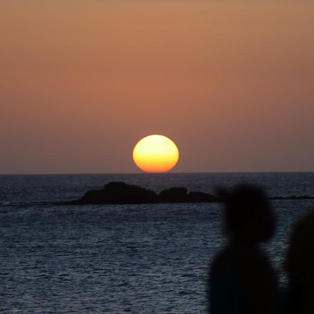 """A Couple Watch the Aruba Sunset"" stock image"