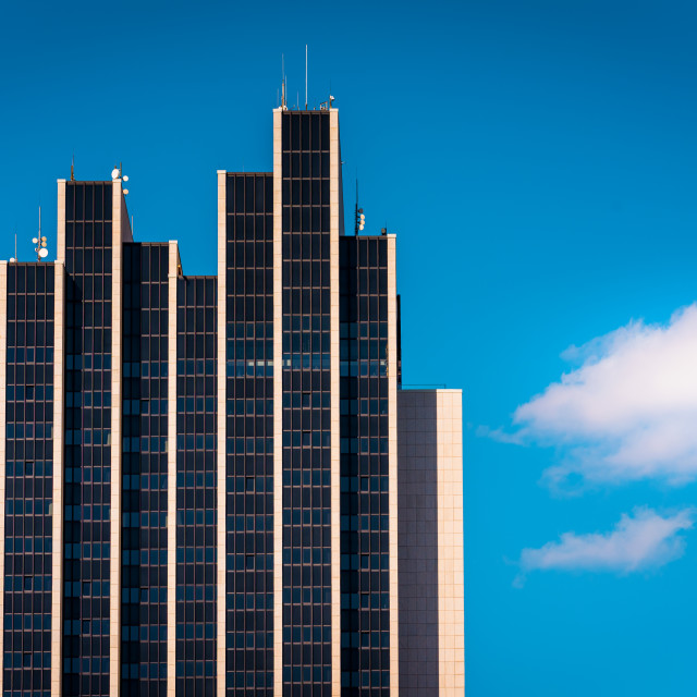 """""""""""Assymetrical Plan"""" - Modern high-rise building against blue sky"""" stock image"""