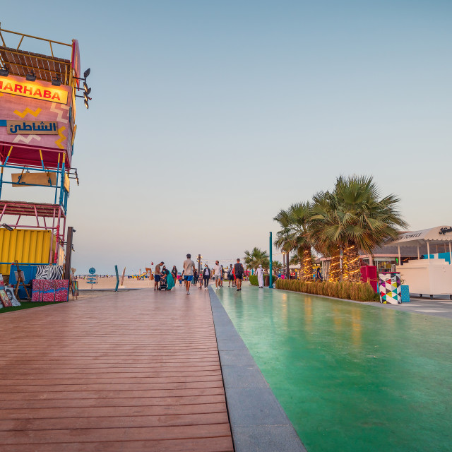 """""""Kite beach in Dubai with large running track, coffee bars and restaurants by the seaside at sunset at one of the most popular public beaches in Dubai"""" stock image"""