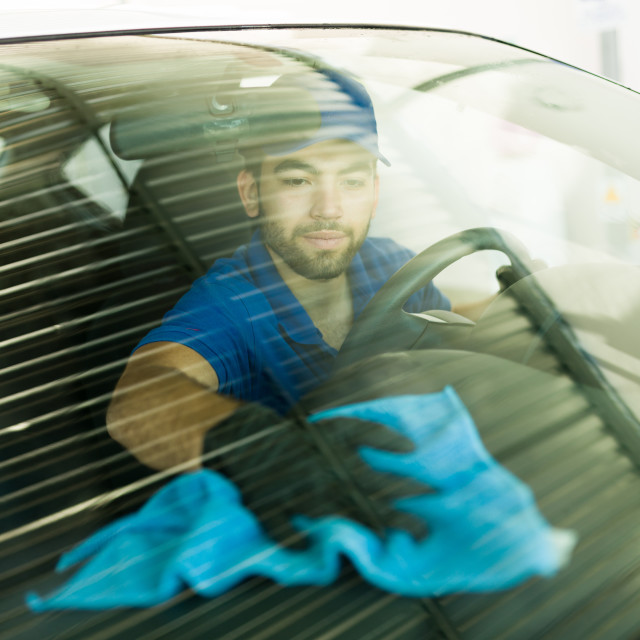 """""""Employee giving the last details in the car wash"""" stock image"""