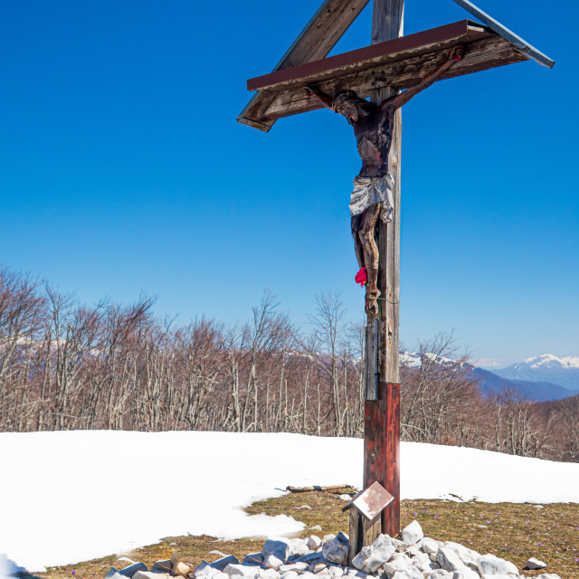 """""""Scenic view of Christian cross on the snowy mountain ridge"""" stock image"""