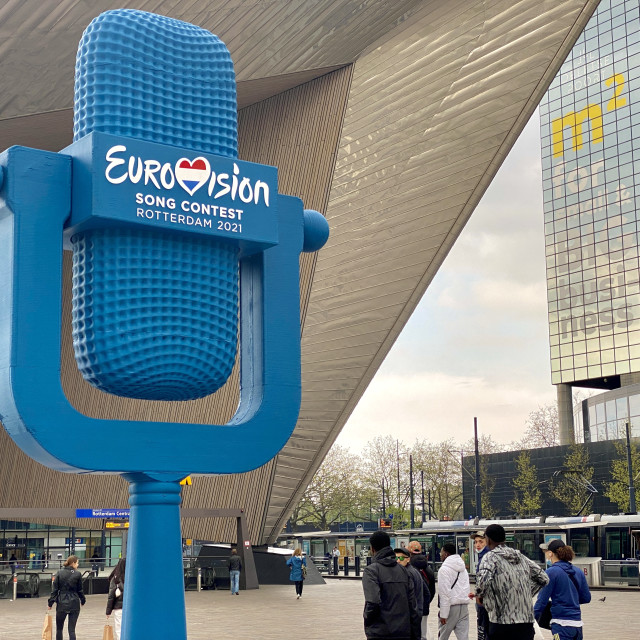 """""""Eurovision Song Contest Rotterdam 2021 blue logo symbol outside Central Railway Station in the city."""" stock image"""