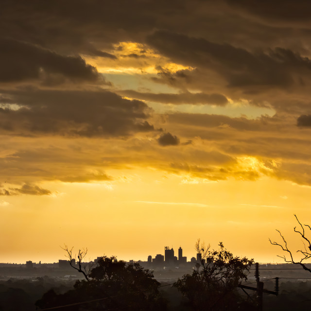 """""""Distant City Skyline at Sunset"""" stock image"""