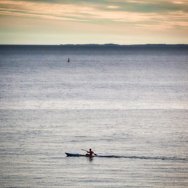 """Lone Kayaker in the Ocean"" stock image"