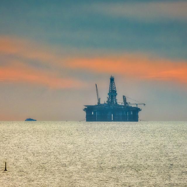 """Oil Platform at Sunset"" stock image"