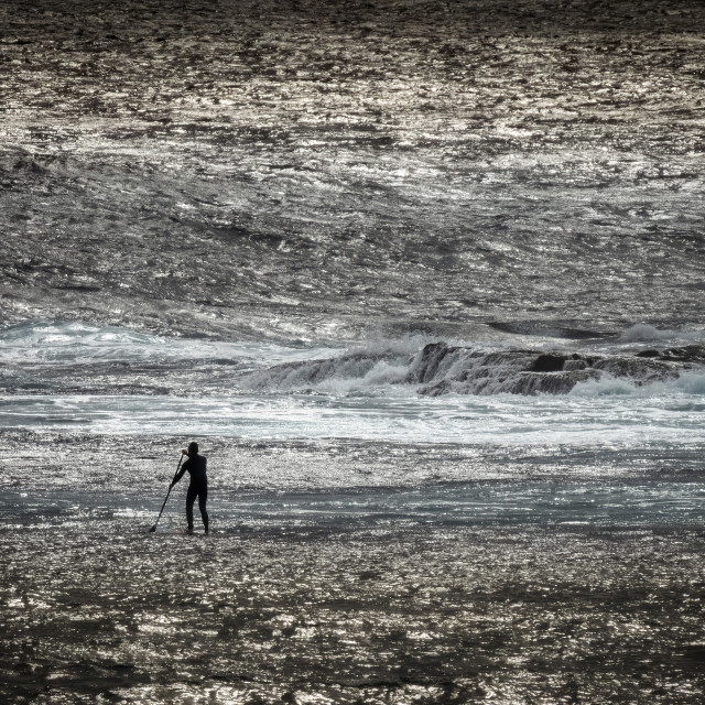 """""""Lone Stand Up Surfer on a Glistening Sea"""" stock image"""
