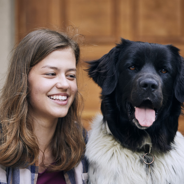 """""""Portrait of laughing teenager girl with her dog"""" stock image"""