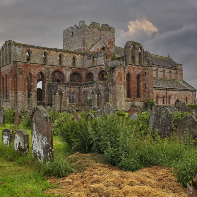 """""""Medieval Lanercost Priory was founded about 1165 by Henry II and was completed in 1220. It fell into ruin after the dissolution of the monasteries by Henry VIII in 1537"""" stock image"""