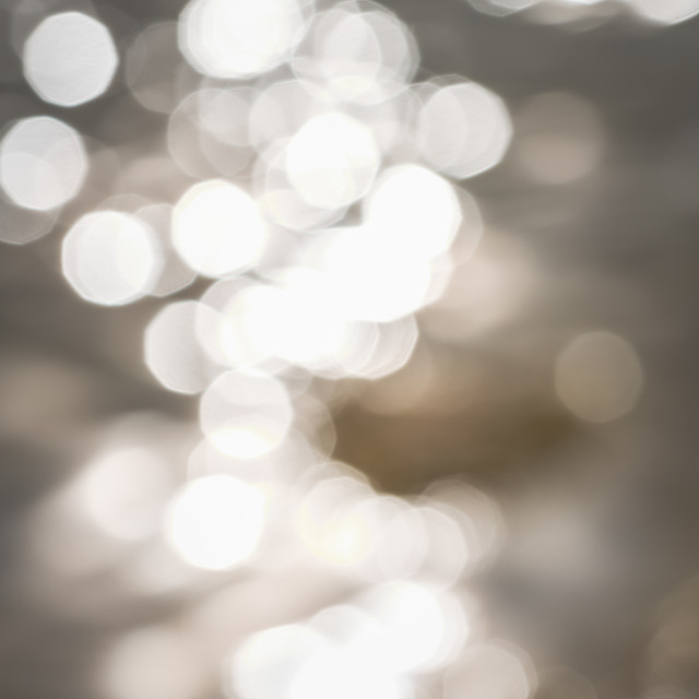 """""""Bokeh on water surface creating texture background on the coast"""" stock image"""