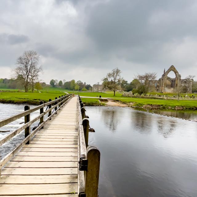 """River Wharfe Footbridge at Bolton Abbey, Yorkshire Dales."" stock image"
