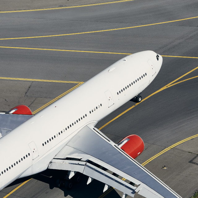 """""""Aerial view of airplane at airport"""" stock image"""