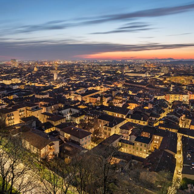 """Brescia city skyline taken at the blue hour, Brescia, Italy"" stock image"