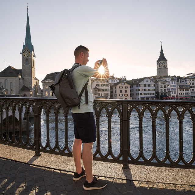 """""""Man photographing cityscape of old town"""" stock image"""