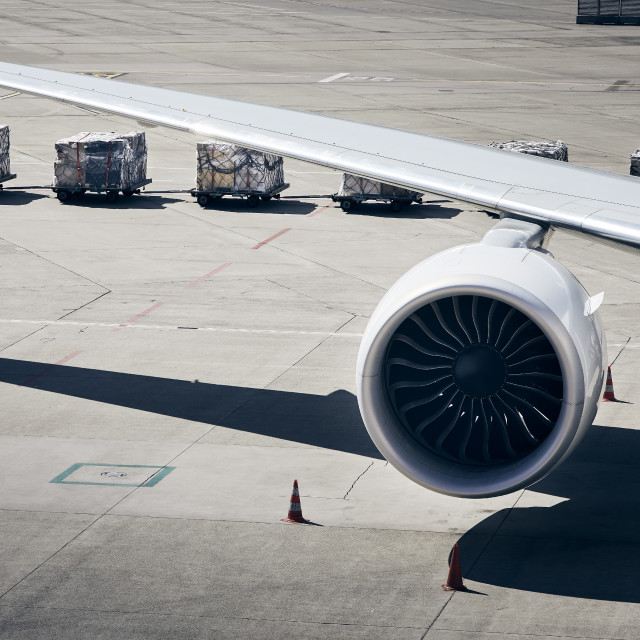 """""""Loading of cargo containers to plane at airport"""" stock image"""