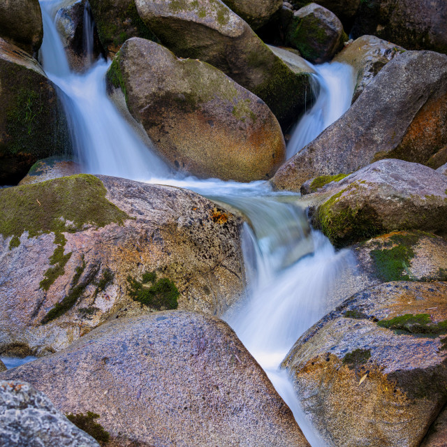 """""""Long exposure picture from a small brock with nice rocks"""" stock image"""
