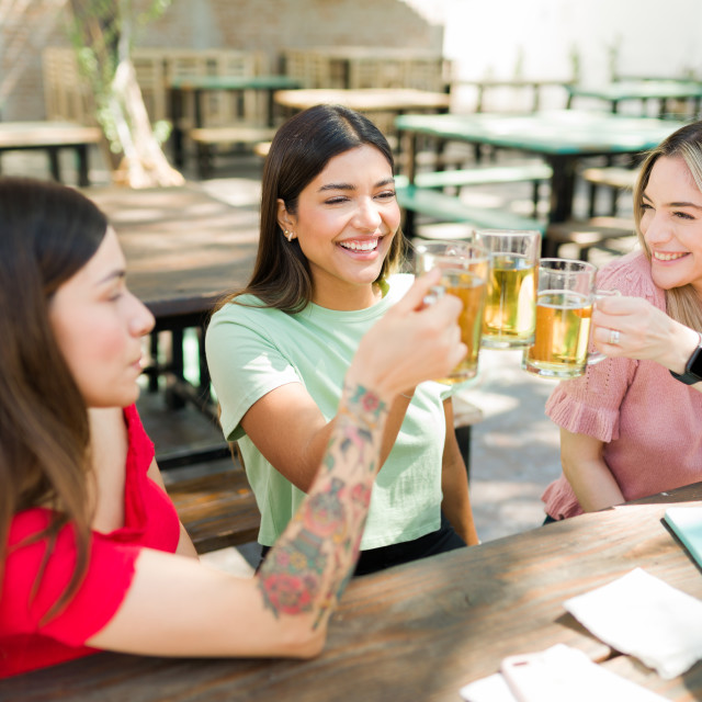 """""""Beautiful women meeting for drinks at the bar"""" stock image"""