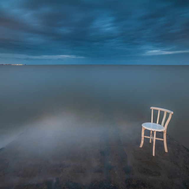 """""""Chair sitting in the sea"""" stock image"""